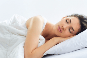 Woman sleeping in bed dreaming