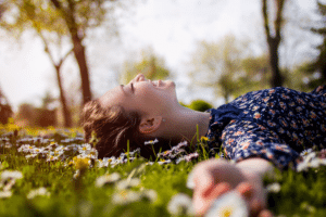Young woman relaxing on the grass smiling