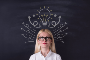 Woman thinking with light bulb above head