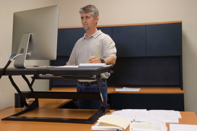 Man using stand up desk in office