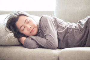 Woman sleeping on lounge