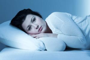 Woman in bed awake