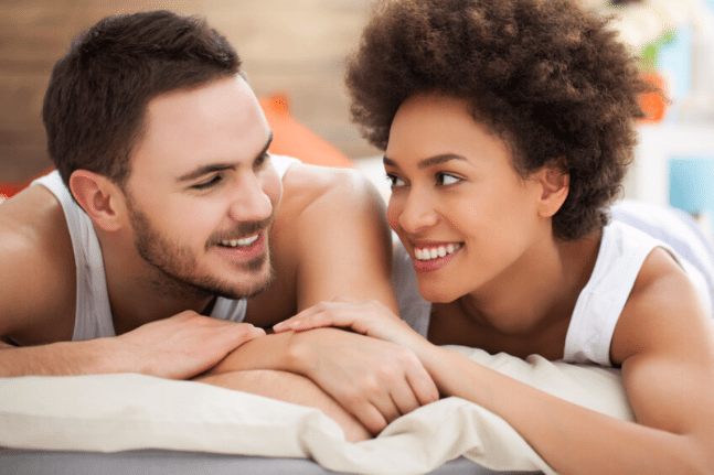 Mixed race couple happy in bed