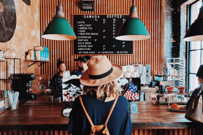 Woman buying food in a cafe