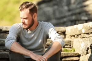 Man sitting outside thinking
