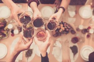 Toasting wine at dinner table