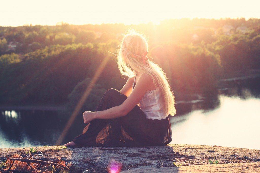 A calm woman outdoors