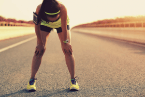 Woman taking a breath after running