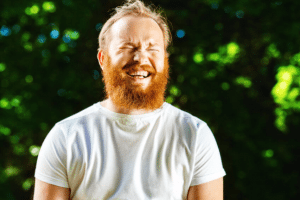 Man laughing outside