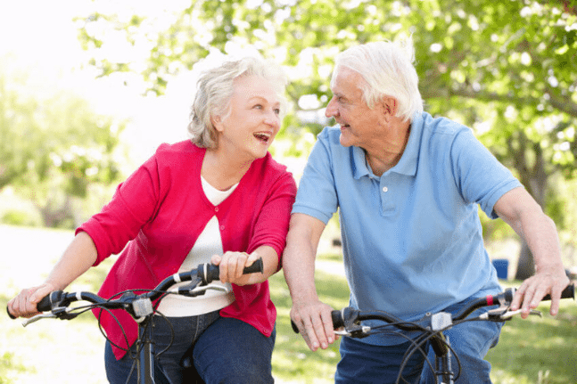 Senior couple riding bicycles together