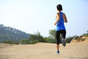 50334039 - young woman runner legs running on mountain trail
