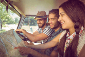 Friends on a road trip reading a map