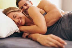 Young couple in love lying on bed