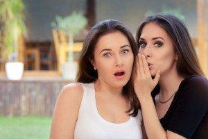 43834870 - two best friend girls whispering a secret