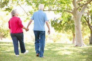 senior couple taking a walk in the park