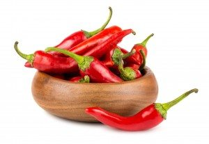 red hot chilli peppers in a wooden bowl