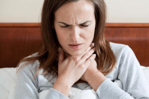 women pain reflux sore throat sad cold flu