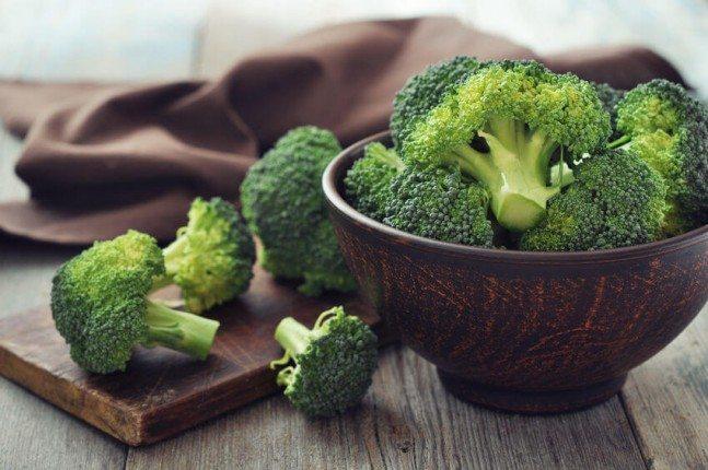 bowl of broccoli amd broccoli on a wooden board
