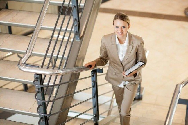 female office worker walking up the stairs