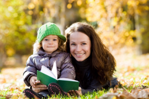 woman child kid patience reading happy family having fun in autumn park