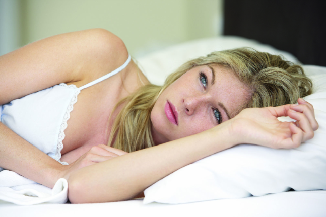 depression Worried Looking Young Woman On Bed