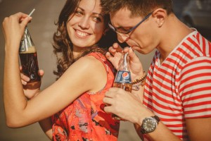 Close up of beautiful young smiling couple and drinking pepsi