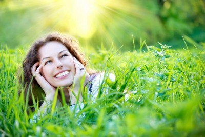 happy woman lying in tall grass