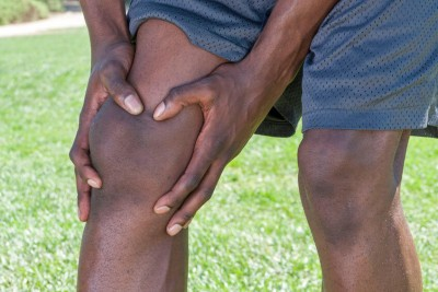 close up of knees of an African American male