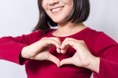 woman showing a heart with hands