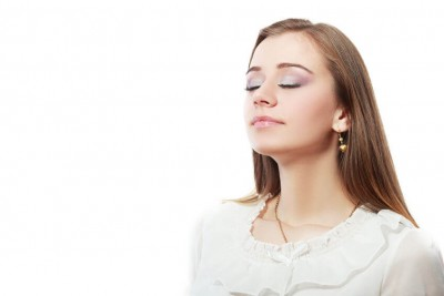 woman smelling the air and her eyes are closed