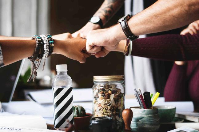 progressionist, work health wellness workplace team work