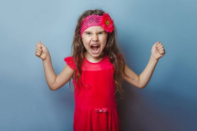 young girl child screaming with anger