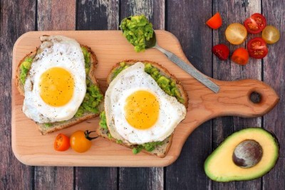 eggs fried sunny side up served with avocado mash on toast