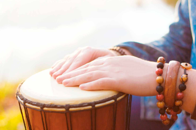 Playing the djembe drum with rhythmic healing