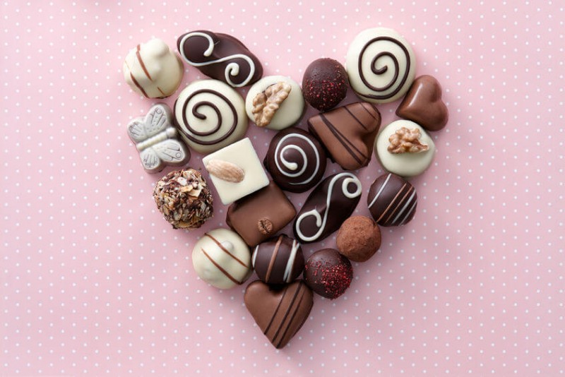 Chocolate candies heart shape composition
