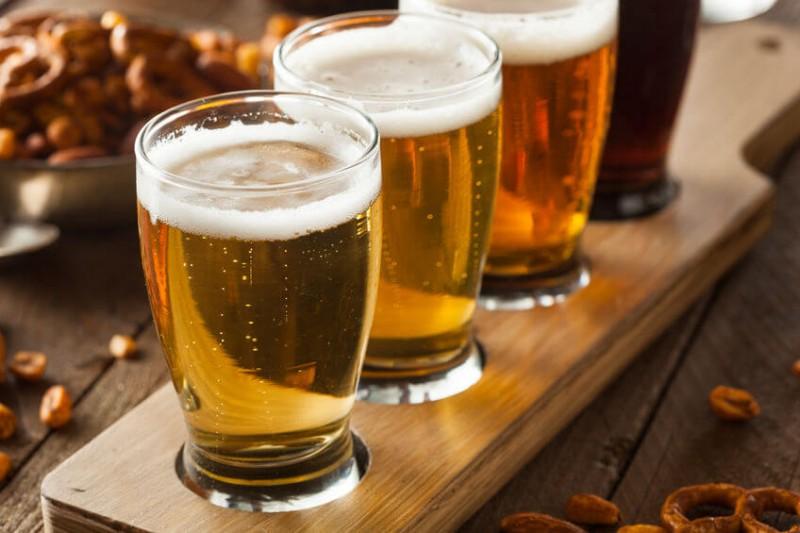 glasses of beer in a wooden tray