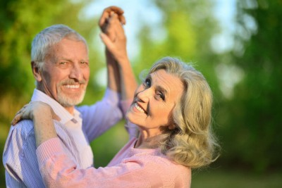 older couple dancing in the park