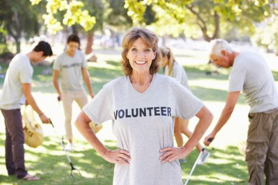 older woman volunteering with others