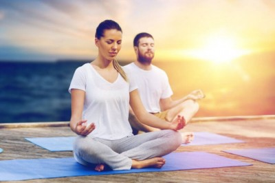 mand and woman practising meditation
