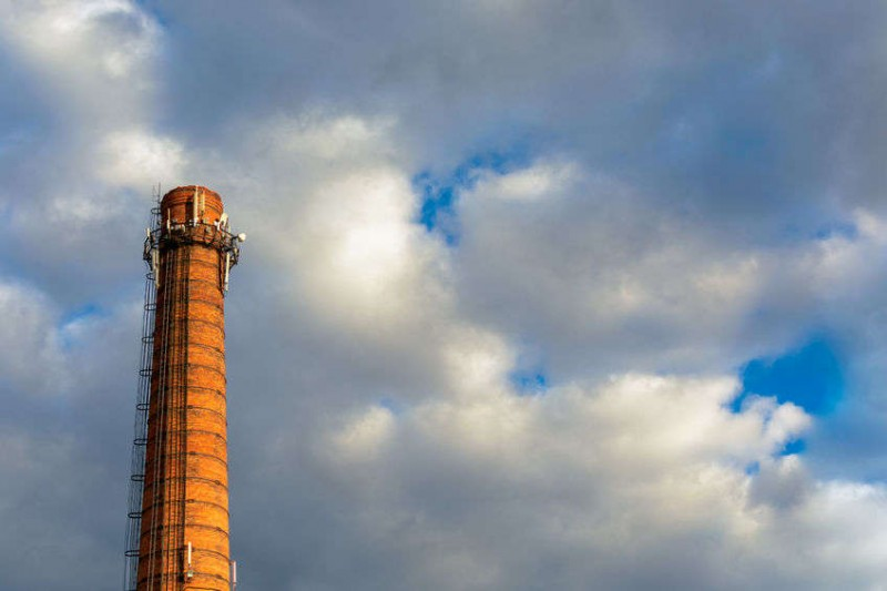 factory chimney against a blue sky
