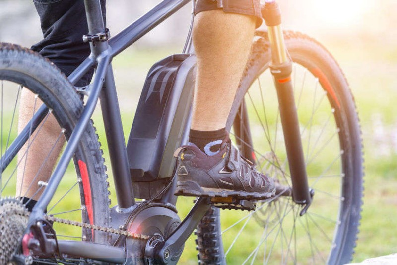 close up of man's legs riding an ebike