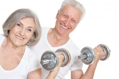 senior couple exercising with weights in their hands