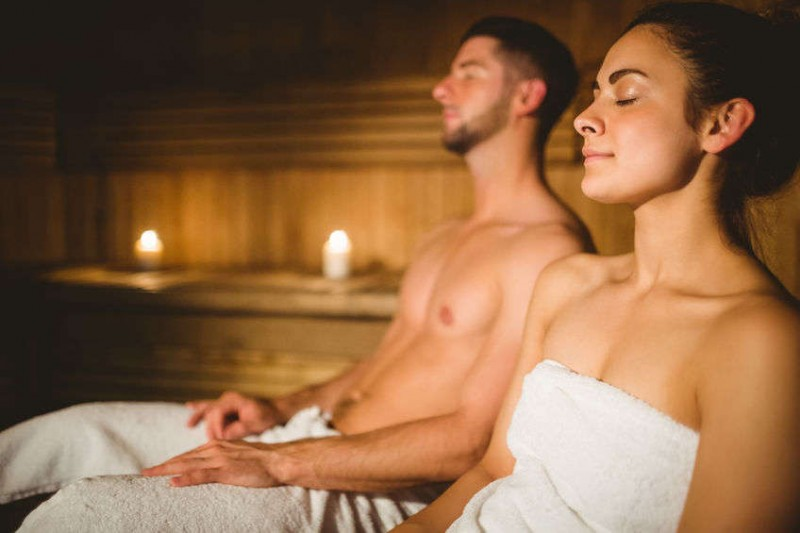 couple enjoying the sauna together at the spa