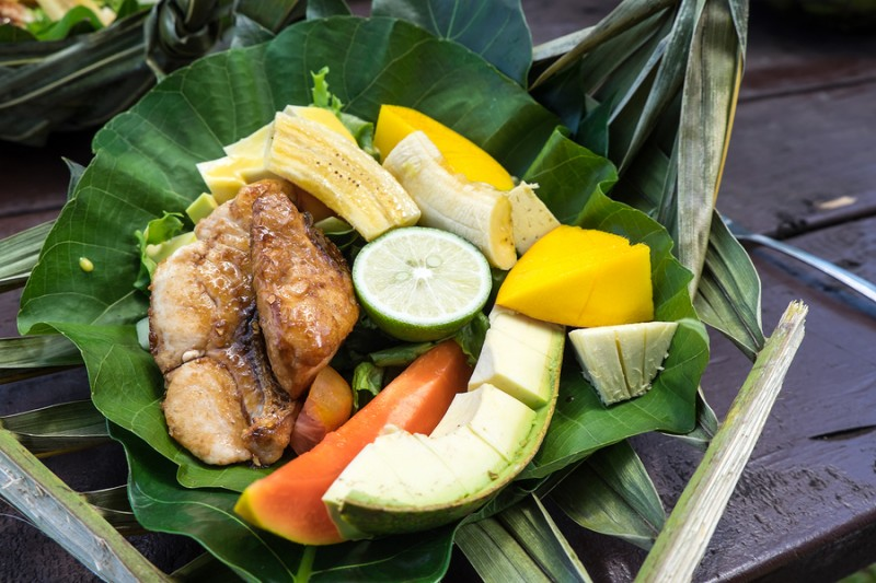 Healthy Lunch Of Fish And A Salad Of Fresh Fruit And Vegetables