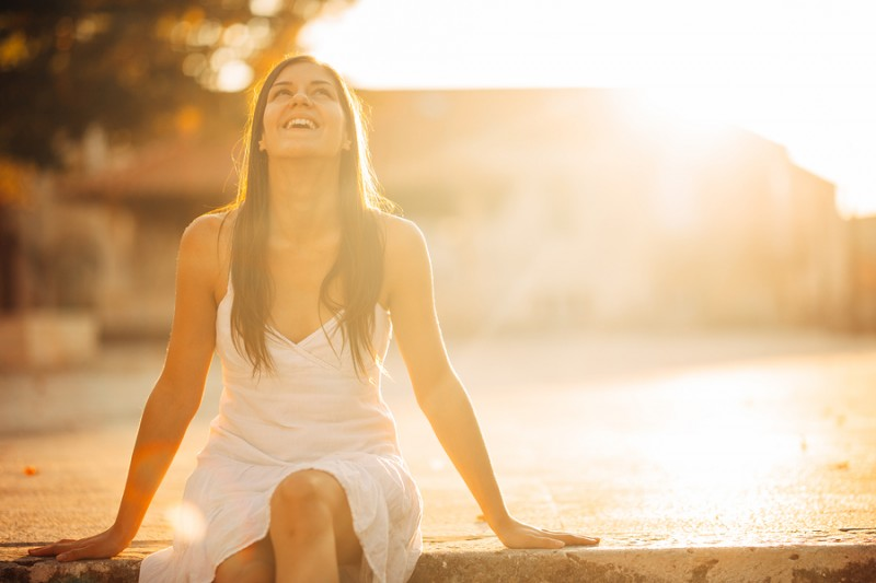 woman sitting and enjoying being outside in nature