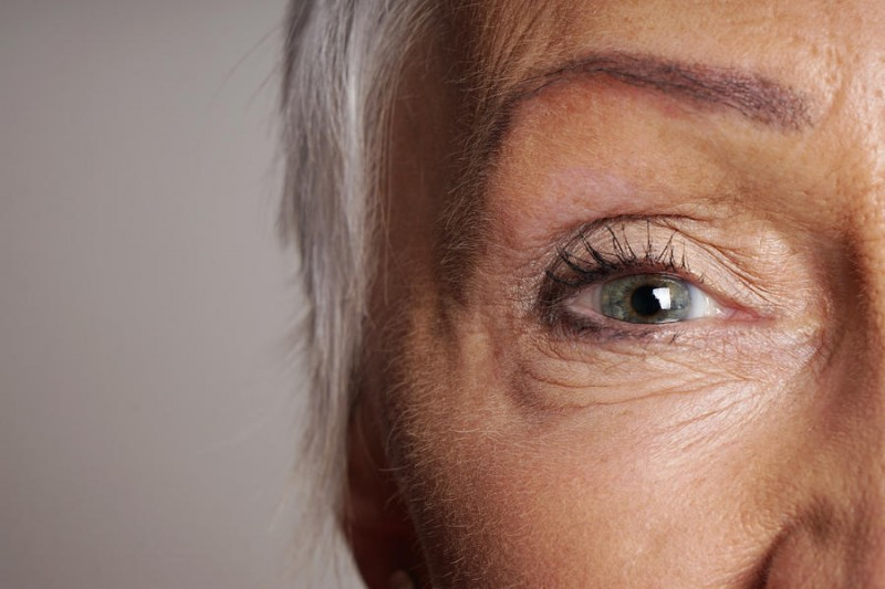 close up of mature woman with green eyes