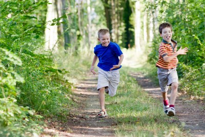 Save Download Preview Young children running in nature