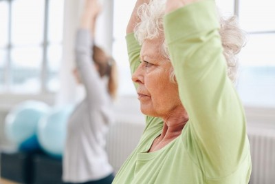 Close-up image of senior woman practicing yoga