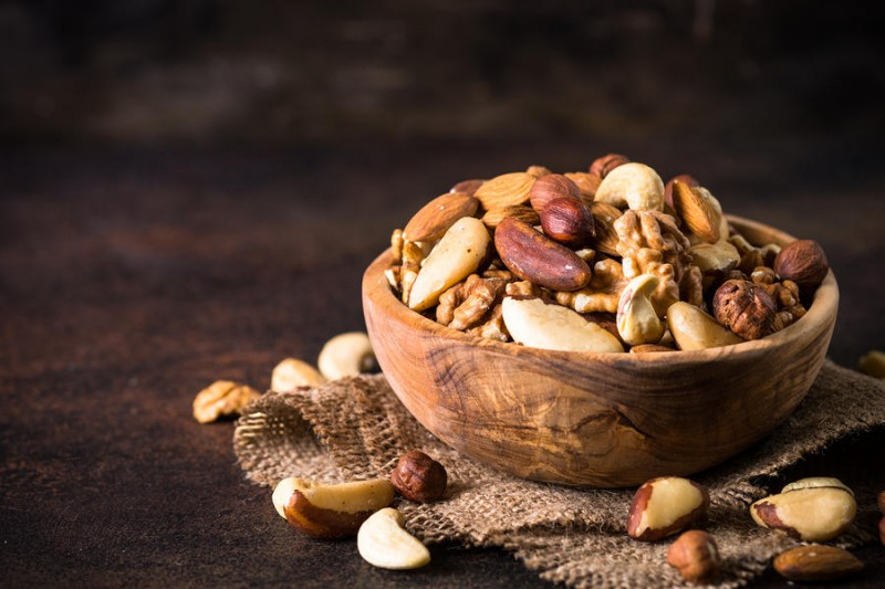Save Download Preview Assortment of nuts in wooden bowl