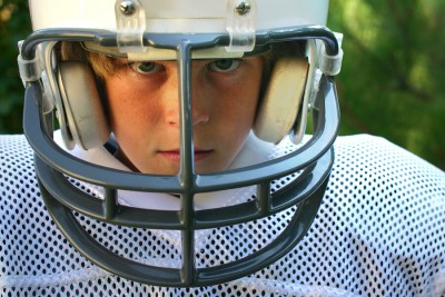 closeup of a boy in a football uniform